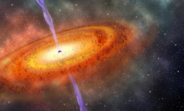 Artist's conception of the most-distant supermassive black hole ever discovered, which is part of a quasar from just 690 million years after the Big Bang is shown in this illustration released on December 6, 2017. Courtesy Robin Dienel/Carnegie Institutio