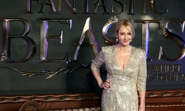 """Writer J.K. Rowling poses as she arrives for the European premiere of the film """"Fantastic Beasts and Where to Find Them"""" at Cineworld Imax, Leicester Square in London, Britain November 15, 2016. REUTERS/Neil Hall"""