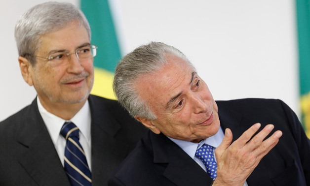 FILE PHOTO: Brazil's President Michel Temer (R) attends a ceremony at Planalto Palace with Brazilian Minister of Government Secretariat Antonio Imbassahy in Brasilia, Brazil, December 6, 2017. REUTERS/Adriano Machado