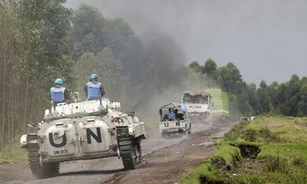 File Photo: UN peacekeepers drive their tank as they patrol past the deserted Kibati village near Goma in the eastern Democratic Republic of Congo, August 7, 2013. Reuters