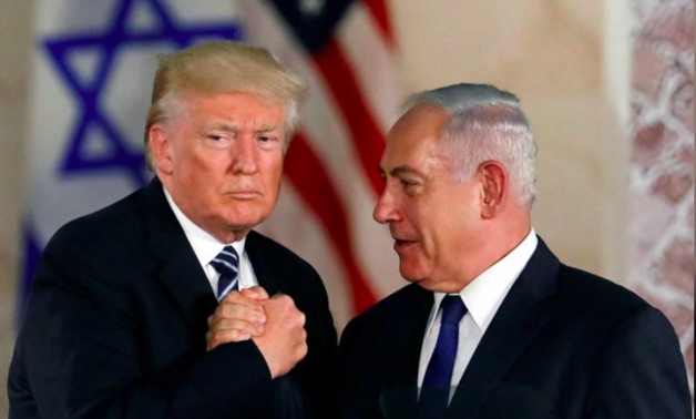 U.S. President Donald Trump and Israeli Prime Minister Benjamin Netanyahu shake hands after Trump's address at the Israel Museum in Jerusalem May 23, 2017 - REUTERS/Ronen Zvulun