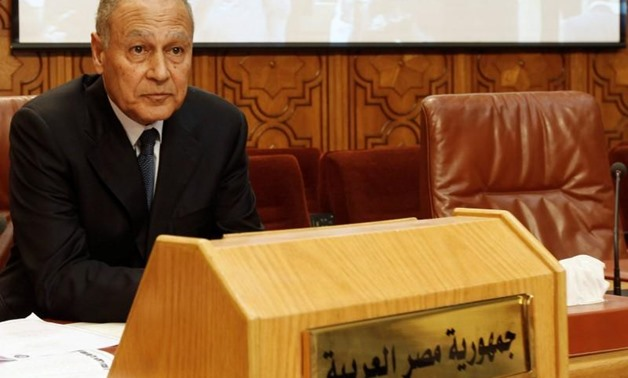 Ahmed Aboul Gheit sits beside an unoccupied seat for the Libyan foreign minister, at the opening of an emergency meeting among the Arab League foreign ministers, held to discuss issues about Libya, at the headquarters in Cairo March 2, 2011. REUTERS/Amr A