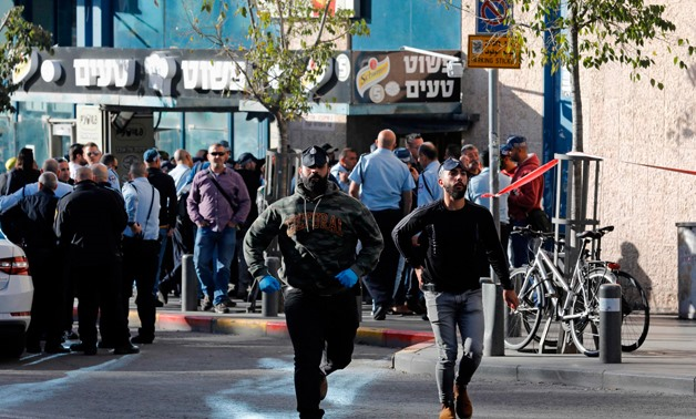 Israeli police gather at the entrance of the central bus station in Jerusalem following a reported stabbing attack on December 10, 2017