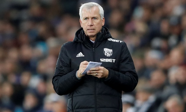 Soccer Football - Premier League - Swansea City vs West Bromwich Albion - Liberty Stadium, Swansea, Britain - December 9, 2017 West Bromwich Albion manager Alan Pardew takes notes during the match Action Images via Reuters/Carl Recine