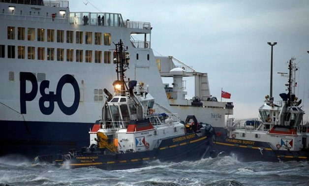 ugboats manoeuvre the P&O ferry Pride of Kent after it ran aground during bad weather in the port of Calais in northern France -REUTERS