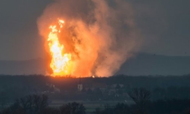 A blaze pictured at Austria's main gas pipeline hub at Baumgarten, eastern Vienna, after explosion rocked the site on December 12, 2017 - AFP