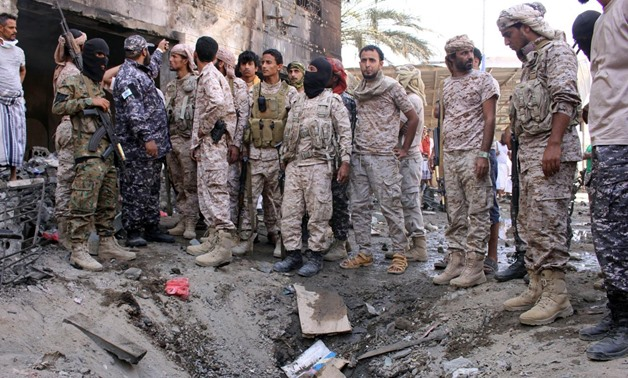 Members of security forces organized by the Saudi-led coalition gather at the site of a suicide car bomb attack outside a police forces camp in Aden, Yemen, November 14, 2017. REUTERS/Fawaz Salman