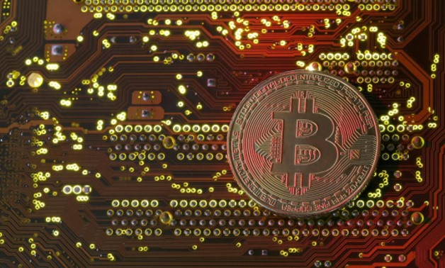 FILE- A copy of bitcoin standing on PC motherboard is seen in this illustration picture, October 26, 2017. REUTERS/Dado Ruvic/File Photo