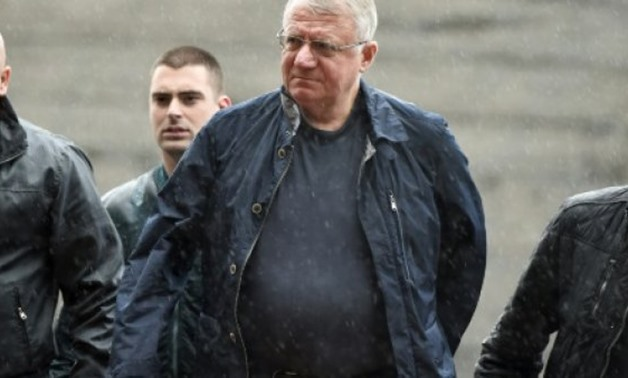 © AFP/File / by Jan HENNOP | The acquittal of Serbian ultranationalist Vojislav Seselj (C), pictured in 2015, is being challenged by UN prosecutors