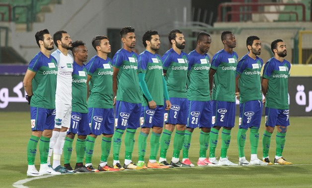 Soccer, al-Ahly vs Misr el-Makasa, 10-12-2017, Misr el-Makasa players pose for a moment of silence – Photo Courtesy of Egypt Today