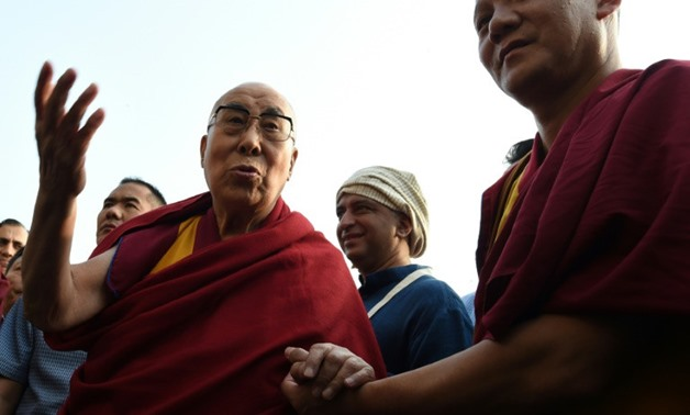The 14th Dalai Lama announced a new iPhone app which will allow devotees to watch live video of his teachings to his 16.6 million Twitter followers on Thursday - AFP/File / INDRANIL MUKHERJEE