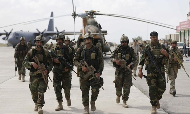 Afghan security forces arrive at the Kunduz airport in Afghanistan on April 30, 2015.