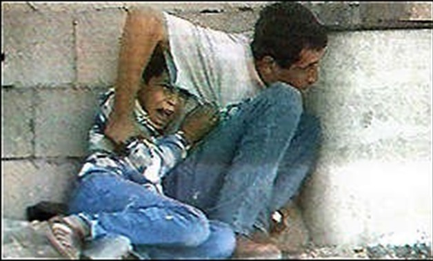 Jamal and Muhammad Al-Durrah being shot; Khan Yunis, Gaza Strip; September 30, 2000 - Wikipedia/ Alberuni