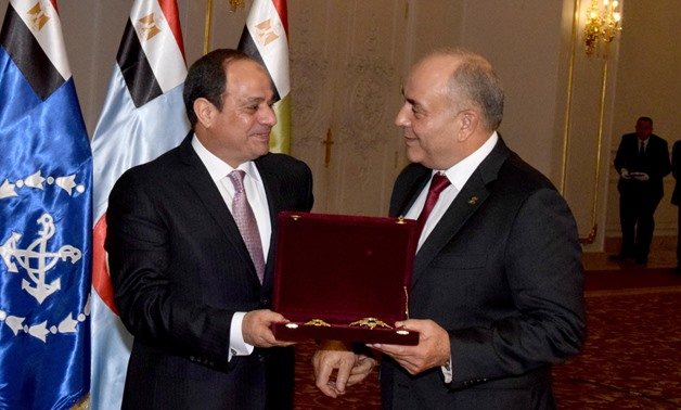 President Abdel Fatah al-Sisi (L) bestows Order of the Republic of the First Class on former Chief of Staff of the Armed Forces, Colonel General Mahmoud Hegazy (R) on Saturday, December 16, 2017- Press photo