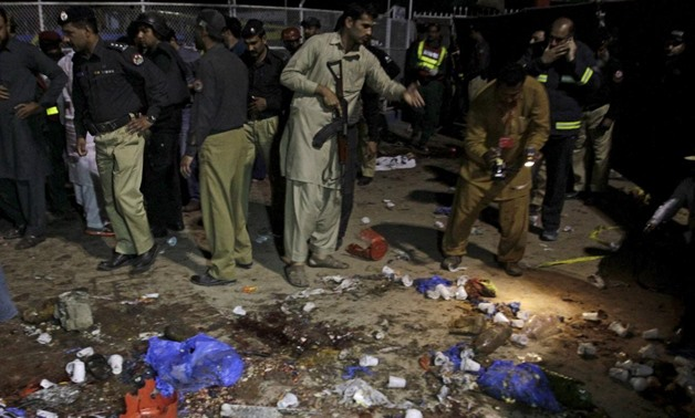 File photo: Security officials gather at the site of a blast outside a public park in Lahore, Pakistan, March 27, 2016. REUTERS/Mohsin Raza