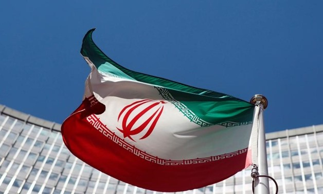 An Iranian flag flutters in front of the United Nations headquarters in Vienna June 17, 2014. REUTERS/Heinz-Peter Bader