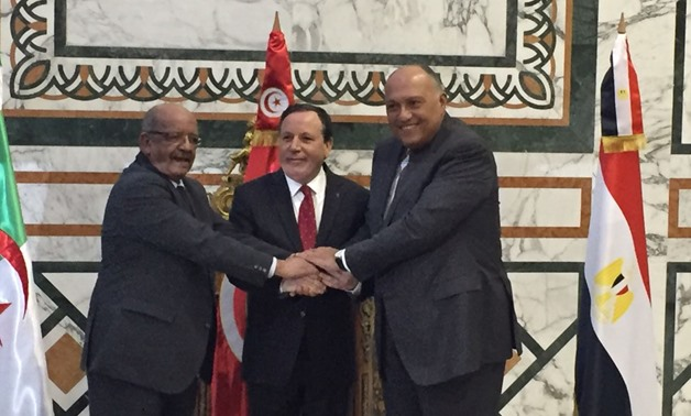 Egypt's Foreign Minister, Sameh Shoukry, with his Tunisian and Algerian counterparts in Tunisia to discuss the Libyan political course on December 17 – Press Photo