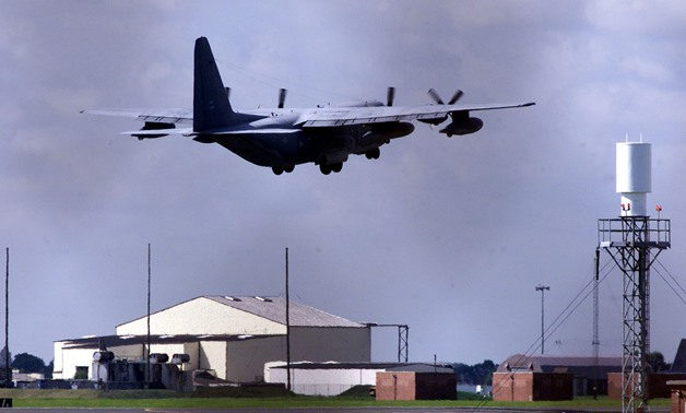 FILE PHOTO: A U.S. Hurricane transport plane takes off from RAF Mildenhall, Suffolk, England, September 15, 2001. REUTERS/Stephen Hird/File Photo