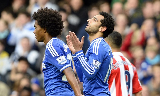 Chelsea's Mohamed Salah (R) celebrates after scoring a goal against Stoke City during their English Premier League soccer match at Stamford Bridge in London April 5, 2014 (Photo: Reuters)