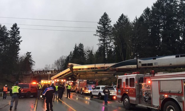 First responders are seen at the scene of an Amtrak passenger train derailment on interstate highway (I-5) in this Washington State Patrol image moved on social media in DuPont, Washington, U.S., December 18, 2017. Courtesy Brooke Bova/Washington State Pa