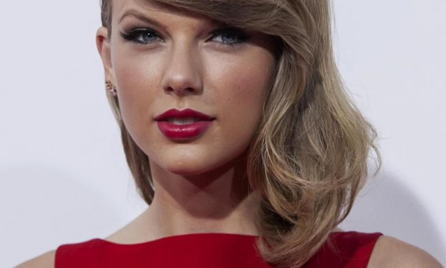 "Taylor Swift attends the premiere of ""The Giver"" in New York, August 11, 2014 – REUTERS/Eric Thayer"