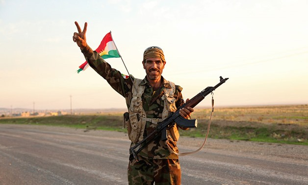 VICTORY: A member of the Kurdish peshmerga just after the forces retook Zumar in October 2014. REUTERS/Ari Jalal