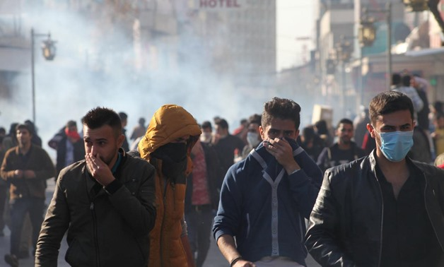 Kurdish protesters run away from tear gaz during a rally against the Kurdistan Regional Government (KRG) in Sulaimaniyah, Iraq December 18, 2017. REUTERS/Stringer.