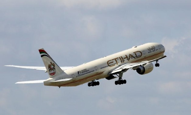 An Etihad Airways Boeing 777-3FX aircraft takes off at the Charles de Gaulle airport in Roissy, France, August 9, 2016 - REUTERS/Jacky Naegelen/File Photo