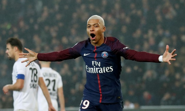 Soccer Football - Ligue 1 - Paris St Germain vs Caen - Parc des Princes, Paris, France - December 20, 2017 Paris Saint-Germain's Kylian Mbappe celebrates scoring their second goal REUTERS/Gonzalo Fuentes