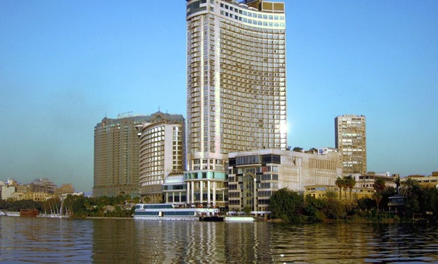 The Grand Nile Tower Hotel (2003) overlooking the river at Cairo, Egypt, was part of the Hyatt chain until 2011. A revolving restaurant is on the 40th floor., Jan. 23, 2013 - Flickr/David Stanley