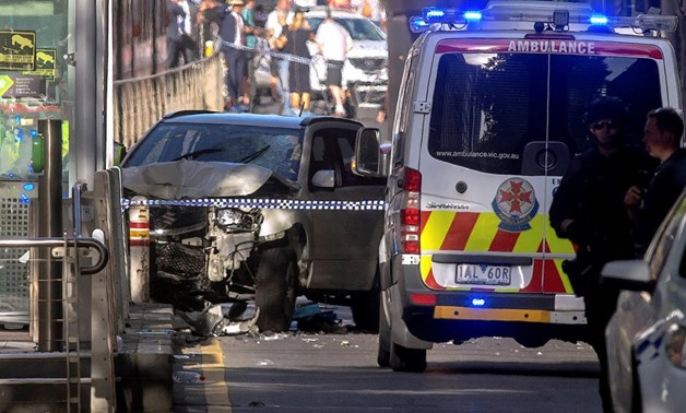 Australian police stand near a crashed vehicle after they arrested the driver of a vehicle that had ploughed into pedestrians at a crowded intersection near the Flinders Street train station in central Melbourne, Australia December 21, 2017. REUTERS/Luis