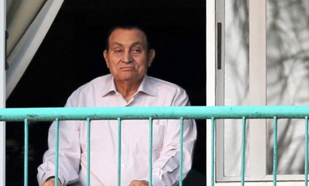 FILE- Ousted Egyptian president Hosni Mubarak looks towards his supporters during celebrations of the 43rd anniversary of the 1973 Arab-Israeli war, at Maadi military hospital on the outskirts of Cairo, October 2016 -  REUTERS/Mohamed Abd El Ghany