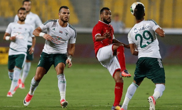 Al Ahly Hossam Ashour in action with Al Masry Hamada Nasser – Reuters