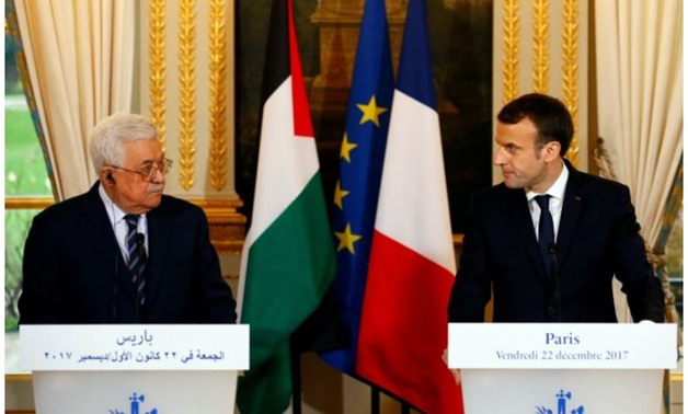 French President Emmanuel Macron (R) and Palestinian President Mahmoud Abbas deliver a press statement after a meeting at the Elysee Palace in Paris, France, December 22, 2017. REUTERS/Francois Mori/Pool