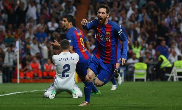 Football Soccer - Real Madrid v FC Barcelona - Spanish Liga Santander - Santiago Bernabeu, Madrid, Spain - 23/4/17 Barcelona's Lionel Messi celebrates scoring their third goal, Reuters, Stringer Livepic