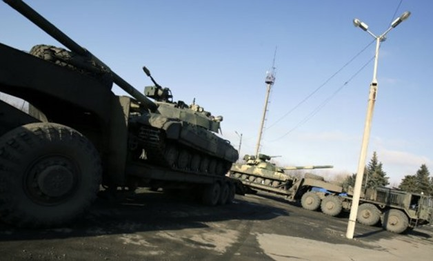 Ukrainian forces ride tanks on the road from Artemivsk to Debaltseve, in the Donetsk region, in February 2015 - AFP/Anatolii Stepanov