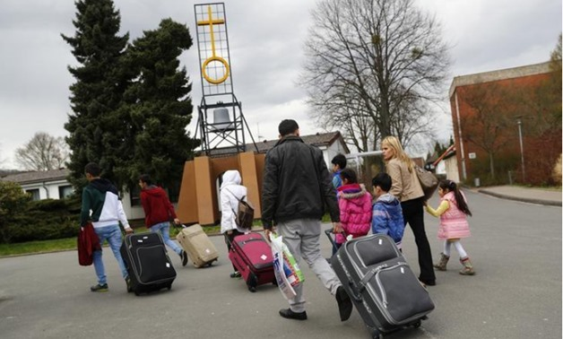 Syrian refugees arrive at the camp for refugees and migrants in Friedland, Germany April 4, 2016 -  REUTERS/Kai Pfaffenbach
