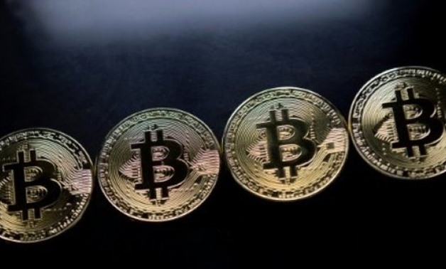 The eye-watering surge in Bitcoin has come with several warnings that a bubble is about to burst - AFP