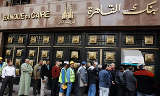 Photo of people standing in the line to make withdrawals outside Banque Du Caire in downtown Cairo-Reuters