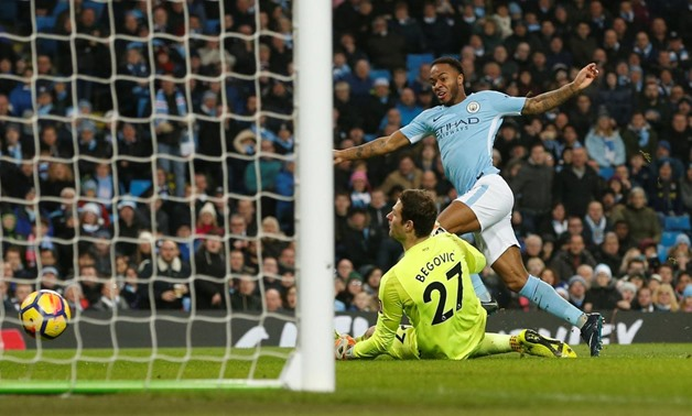 Soccer Football - Premier League - Manchester City vs AFC Bournemouth - Etihad Stadium, Manchester, Britain - December 23, 2017 Manchester City's Raheem Sterling scores their second goal past Bournemouth's Asmir Begovic