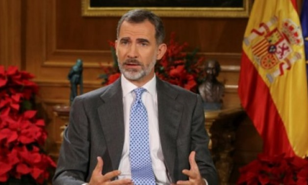 © POOL/AFP / by Serene ASSIR | Spain's King Felipe VI delivers his Christmas Eve message at the Royal Palace in Madrid on December 24, 2017, where he urged Catalan lawmakers to avoid a confrontation over independence