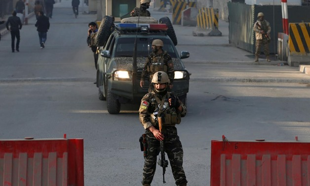 Afghan security forces keep watch at a check point close to the compound of Afghanistan's national intelligence agency in Kabul, Afghanistan. December 25, 2017. REUTERS/Omar Sobhani