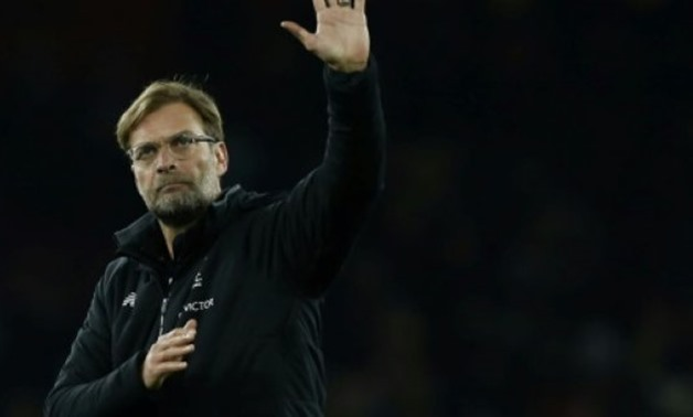 © AFP/File / by Timothy Abraham | Liverpool manager Jurgen Klopp has acknowledged ahead of Liverpool's clash with bottom side Swansea that a Premier League title challenge is beyond them