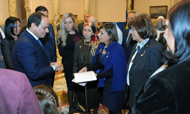 Egyptian President Abdel Fatah Al-Sisi, Maya Morsy along with the National Council of Women Members - Egypt Today