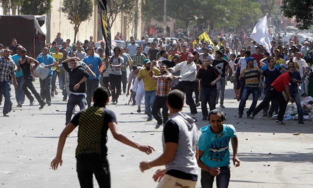 File- Supporters of deposed President Mohamed Mursi and the Muslim Brotherhood clash with anti-Mursi protesters during a march in Shubra street in Cairo October 4, 2013. REUTERS/ Mohamed Abd El Ghany