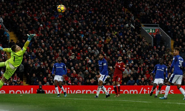 Soccer Football – Premier League – Liverpool vs Everton – Anfield, Liverpool, Britain – December 10, 2017, Liverpool's Mohamed Salah scores their first goal past Everton's Jordan Pickford Action Images – Reuters/Lee Smith