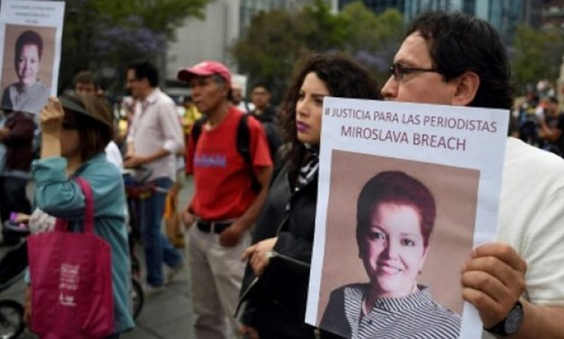 A protest in Mexico City in March 2017 against the murder of journalist Miroslava Breach, who had written about the country's drug war before she was gunned down - FILE / AFP