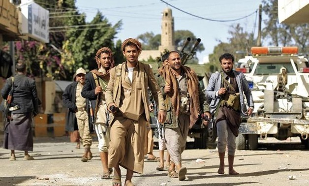 Houthi rebel fighters outside the residence of former Yemeni President Ali Abdullah Saleh in Sanaa on December 4, 2017 - AFP/Mohammed Huwais
