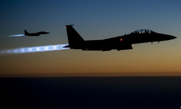 A pair of U.S. Air Force F-15E Strike Eagles fly over northern Iraq after conducting airstrikes in Syria, in this U.S. Air Force handout photo/Reuter