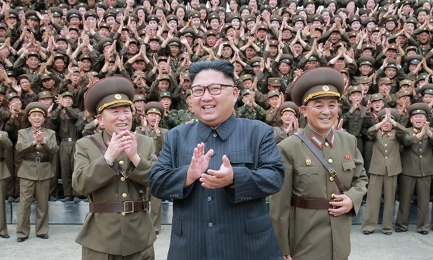 North Korean leader Kim Jong Un claps with military officers at the Command of the Strategic Force of the Korean People's Army (KPA) in an unknown location in North Korea in this undated photo released by North Korea's Korean Central News Agency (KCNA) on